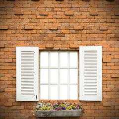 Open Window With Flower Basket On Brick  Wall