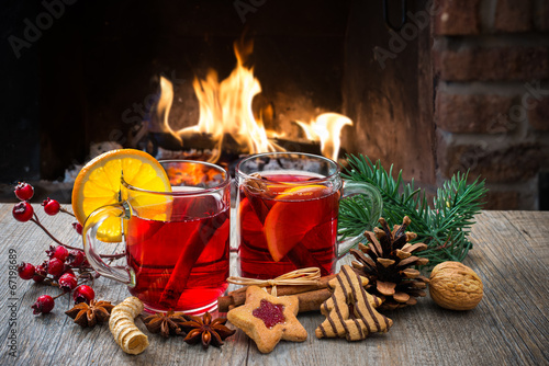 Foto op Canvas Thee Mulled wine at romantic fireplace