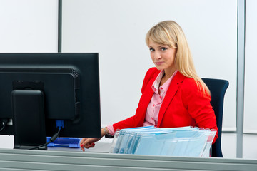 attractive blond woman in office smiling