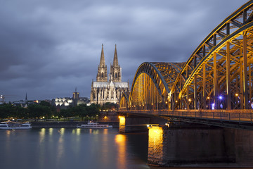 Cologne Cathedral and Hohenzollern Bridge in evening