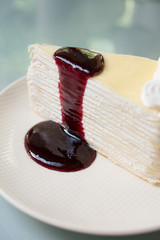 Crepe cake with mulberry sauce.