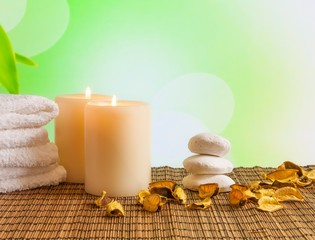 Spa massage border with towel stacked and candles