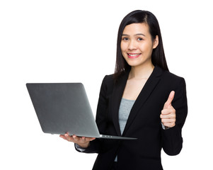 Asian business woman with laptop computer and thumb up