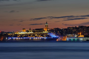 Istanbul night view with galata tower and cruise