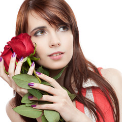 attractive thoughtful girl holding red roses