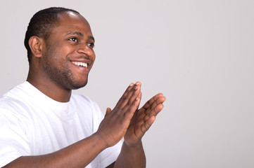 handsome black man clapping hands.