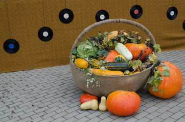 autumn decoration of vegetable in wicker backet