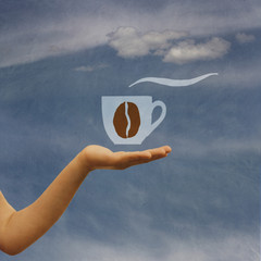 on hand offering coffee, background sky with cloud