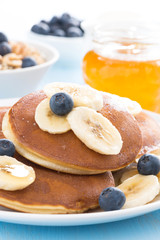 pancakes with banana, honey and blueberry, close-up