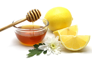 Honey and lemon on white background