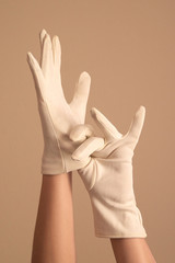 woman modeling vintage knit white gloves