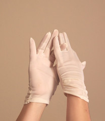 woman modeling and adjusting vintage formal white gloves