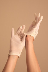woman putting on vintage white gloves