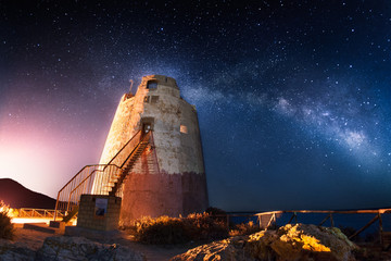Coastal tower under the milky way