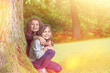 Two Girls under Tree in sunlight