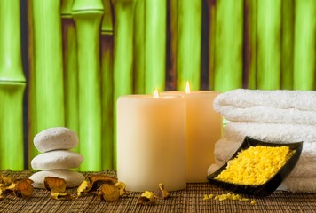 Spa massage border with towel stacked, candles and sea salt