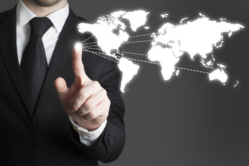businessman pressing touchscreen worldmap