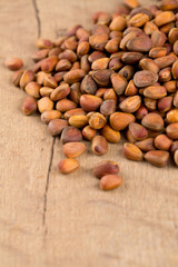 pine nuts on wooden surface