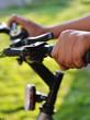 hands holding the handlebars on the bike
