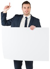 Businessman holding card and pointing