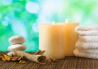 Spa massage border with towel stacked, candles