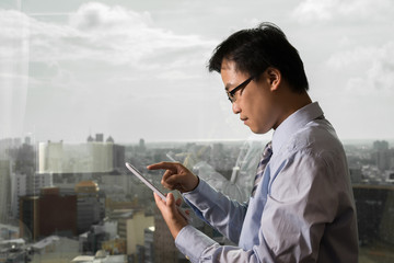 Asian businessman using tablet