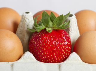 Eggs and strawberry.