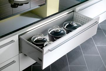 Detail off white glossy kitchen