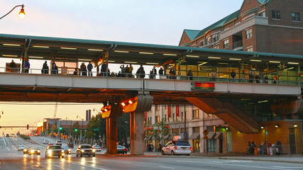 People on Roosevelt CTA Station at twilight sky