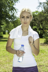 young attractive woman holding a bottle of water