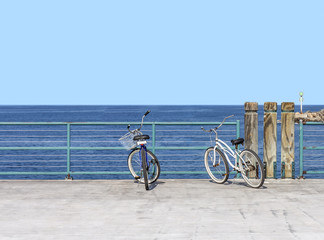 Two bicycles on pier facing the blue ocean horizon