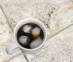 Cold iced black coffee,white ceramic mug,granite tile background