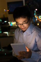 man using tablet at night