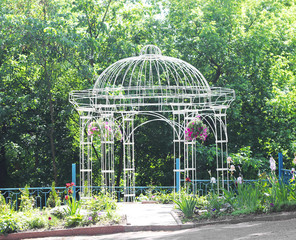 beautiful openwork metal arbor in the garden