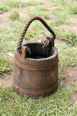 A Medieval Style Wooden Bucket with a Rope Handle.
