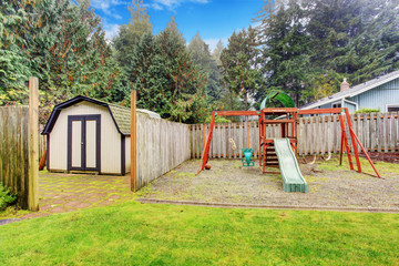 Backyard with shed and playground