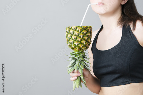 Woman with a cocktail of pineapple