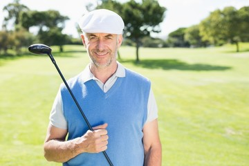 Cheerful golfer smiling at camera