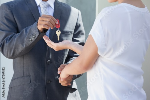canvas print picture Estate agent giving house key to buyer