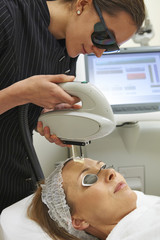 Beautician Carrying Out Fractional Laser Treatment