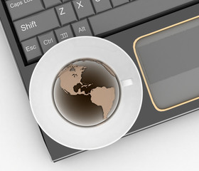 Coffee cup and saucer with globe on computer keyboard