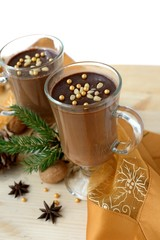 Hot chocolate decorated with pine nuts and candy .