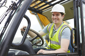 Portrait Of Construction Worker Driving Digger