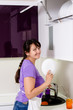 Attractive housewife doing the dishes
