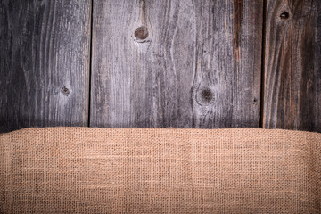 Vintage coffee sack against wooden background
