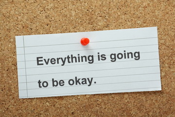 Everything is going to be Okay on a cork notice board