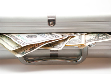 Silver suitcase with Dollar notes showing