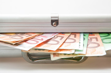 Suitcase with Euro notes showing