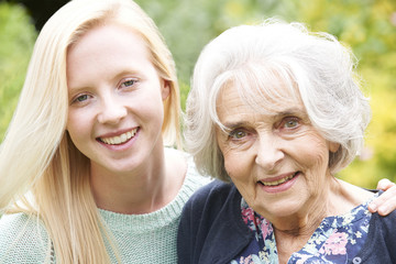 Outdoor Portrait Of Grandmother And Granddaughter