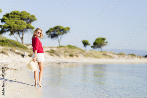 canvas print picture Young woman on the beach